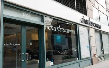 Schwab Accuses Former Adviser of Soliciting a Client
